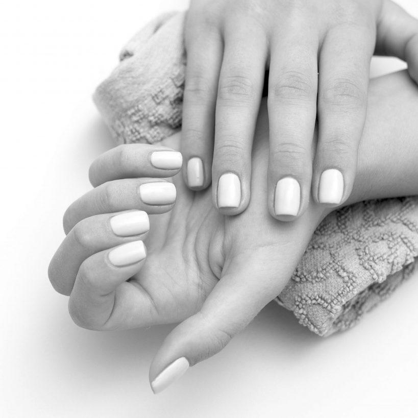 woman-showing-her-beautiful-nails